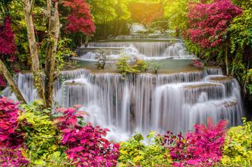 Fototapeta Wodospad Travel to the beautiful waterfall in tropical rain forest, soft water of the stream in the Huai Mae Khamin Waterfall level 4, Khuean Srinagarindra National Park, Kanchanaburi, Thailand