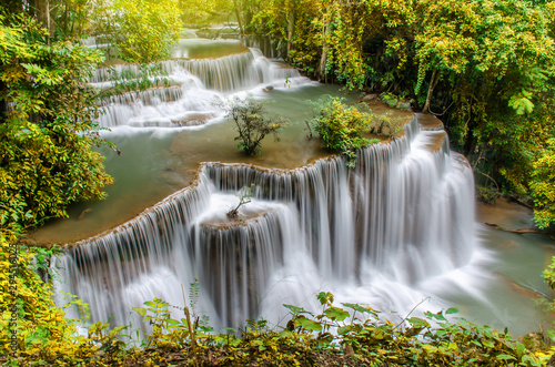 Foto op Canvas Bos rivier Travel to the beautiful waterfall in tropical rain forest, soft water of the stream in the Huai Mae Khamin Waterfall level 4, Khuean Srinagarindra National Park, Kanchanaburi, Thailand