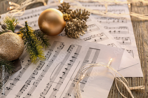 Christmas composition with music notes on table Fototapet