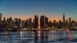 Midtown Manhattan skyline at sunrise in New York, timelapse of rising sun