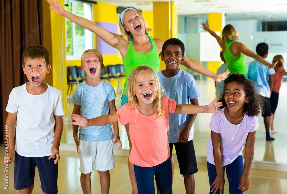 Fototapety, obrazy: Positive children in dance studio smiling and having fun