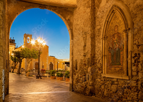 Taormina - The external mosaic of Madonna under Torre dell'Orologio (Porta di Mezzo) tower.