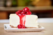 A Slice Of Cherry Cheesecake On A Kitchen Countertop