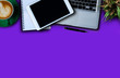 canvas print picture - Office supplies are tablet, pen, computer, notebook, mobile phone and red coffee mug placed at an office desk and have a Blue violet background.