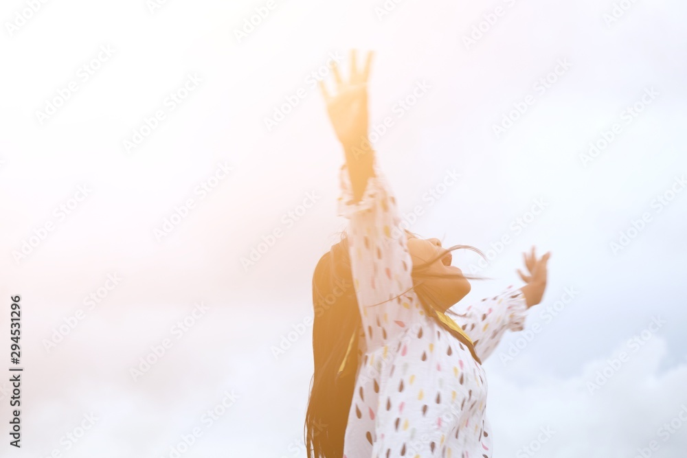 Fototapety, obrazy: Close up happy little girl in colorful dress jumping and laughing hard with sunlight effect. Felling freedom. Blurred concept.