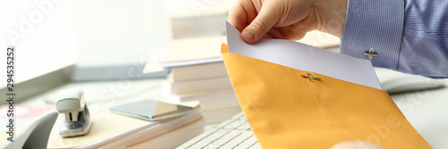 Businessman hold hand yellow mail envelope inbox post concept background Canvas