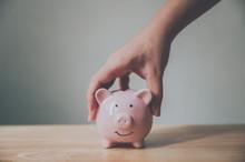 Man Hand Holding Piggy Bank On...