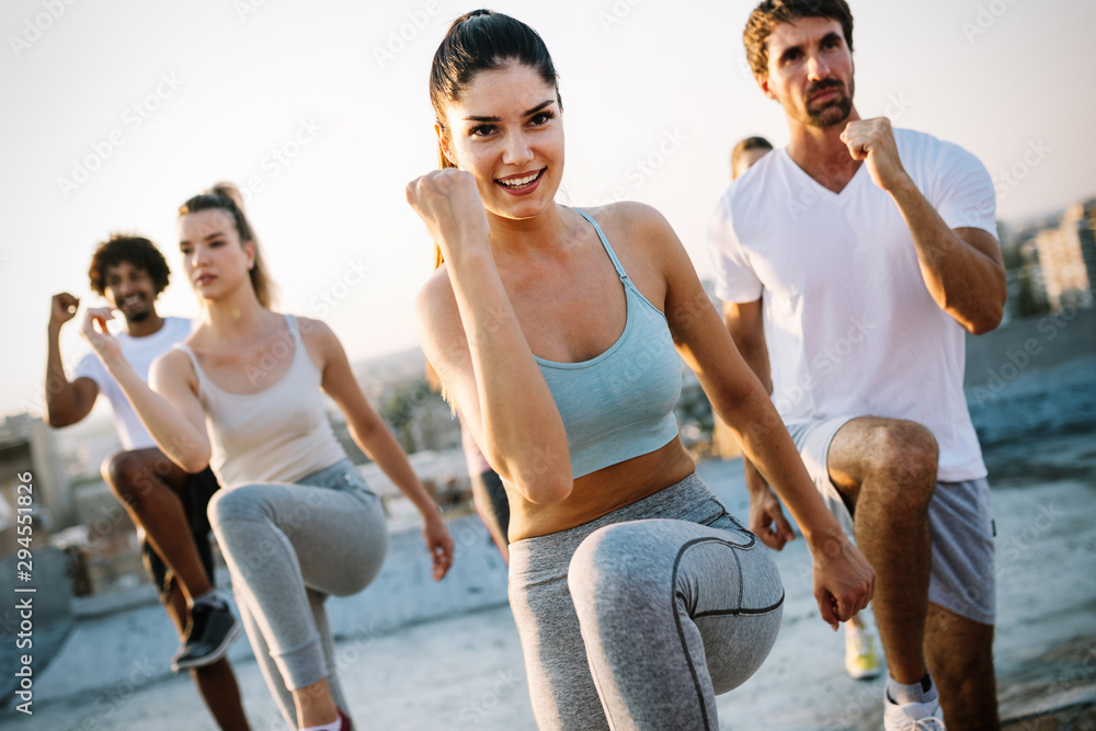 Fototapety, obrazy: Group of happy fit friends exercising outdoor in city