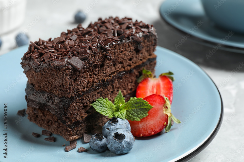Fototapety, obrazy: Delicious fresh chocolate cake with berries on table, closeup