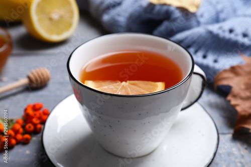 Cup of hot drink on grey wooden table, closeup. Cozy autumn atmosphere - 294560094
