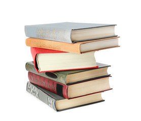 Stack of hardcover books on white background
