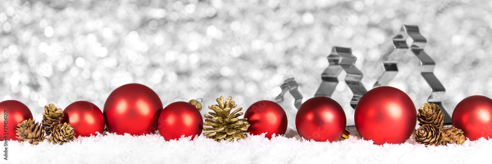 Fototapety, obrazy: Red Baubles and cones in the snow, fir trees in the background