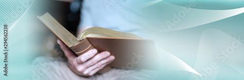 Fotografie, Obraz Man reading the bible; panoramic banner