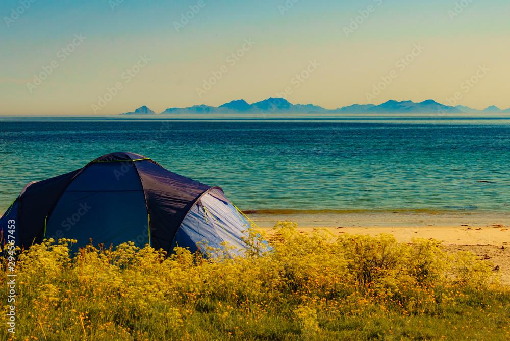 Fototapeta Seascape with tent on beach, Lofoten Norway