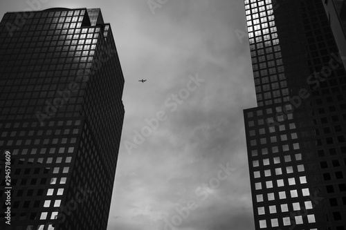 Manhattan modern architecture against cloudy sky background
