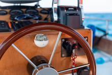 A Boat Wooden Helm And Compass
