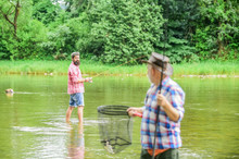 Fisherman With Fishing Rod. Activity And Hobby. Fishing Freshwater Lake Pond River. Bearded Men Catching Fish. Mature Man With Friend Fishing. Summer Vacation. Life Is Always Better When I Am Fishing