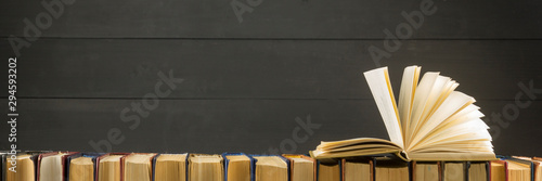 Photo Open book, hardback books on wooden table