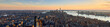 Aerial panoramic view of New York City at Sunset . Brooklyn (left), Midtown and Lower Manhattan (center) with Jersey City (right). USA