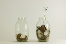 Saving Money Concept Of Collecting Coins (money Thai Bath In Glass Bottles)