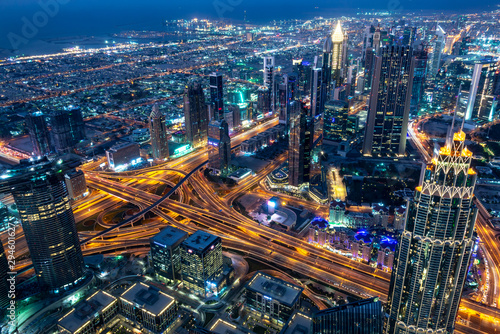 Canvas Print Aerial view of Dubai at night seen from Burj Khalifa tower, United Arab Emirates