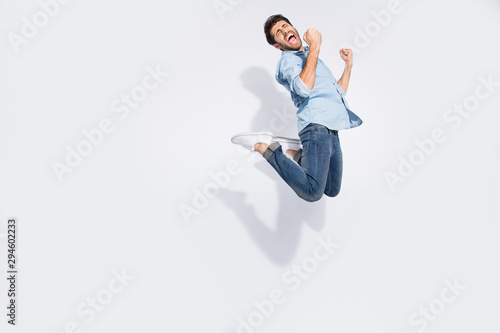 Fotomural Full body profile photo of funny arabian guy jumping high rejoicing of great win