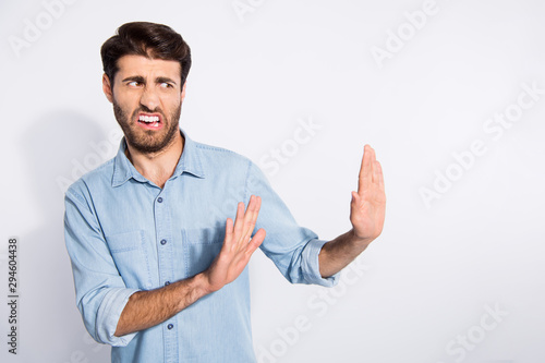 Photo of amazing multiethnic guy looking empty space with disgust stop with arms Canvas Print