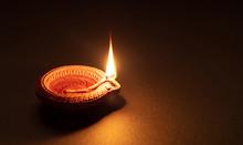 Diwali, Hindu Festival Of Lights Celebration. Diya Oil Lamp Against Dark Background,