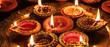 Leinwanddruck Bild - Diwali, Hindu festival of lights celebration. Diya oil lamps against dark background,