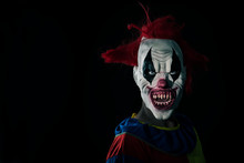 Scary Evil Clown With A Bloody Mouth