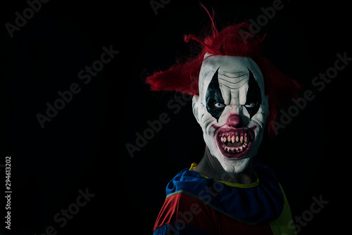 scary evil clown with a bloody mouth Canvas Print