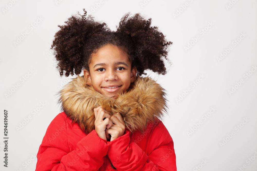 Fototapeta Cute teenage girl in red winter parka