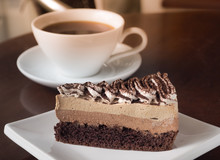 Slice Of Tiramisu Coffee Cake On A White Plate. Chose Up Of Coffee Chocolate Layer Cake.