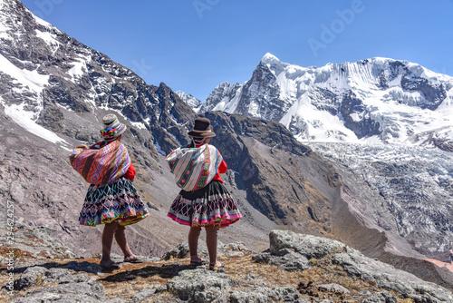 Quechua girls admire Andean mountain views on the Ausungate trail Canvas Print