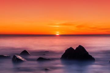 Panel Szklany Morze Atemberaubender Sonnenuntergang über dem Meer