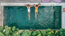 People Relaxing In Pool On Bali Villa