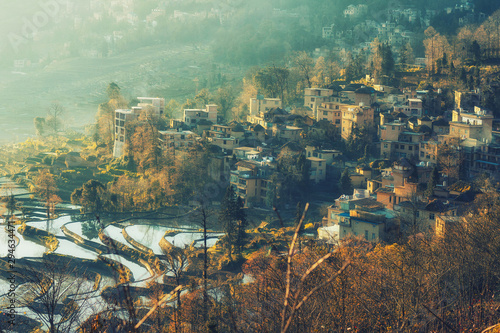 Small village and Terraced rice fields of YuanYang , China in the morning