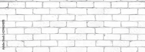 Old shabby white exterior brick wall texture. Cement block whitewashed widescreen background - 294634818