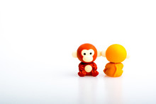 Two Monkey Rubber Toys, Cute Animal Shaped Rubber Doll Isolated In White Background. Toys For Children.