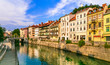 canvas print picture Romantic beautiful Ljubljana city, capital of Slovenia. Urban scene with canals