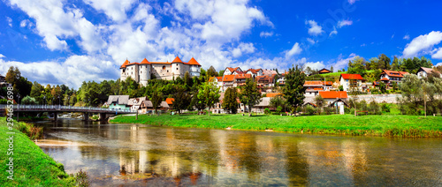 Landmarks of Slovenia - beautiful medieval castle Zuzemberk rising above the Krka River