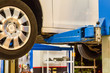 white color car service hydraulic ramp lift car