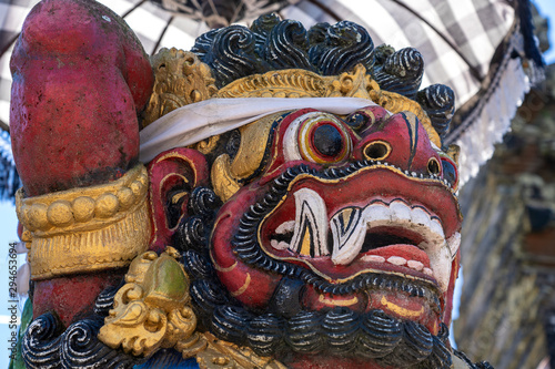 Canvas Print Traditional Balinese demon statue in the street temple