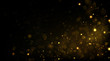 Glowing golden particles on black background