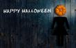 "Leinwandbild Motiv Pumpkin with ""Happy Halloween"" message on wooden background"