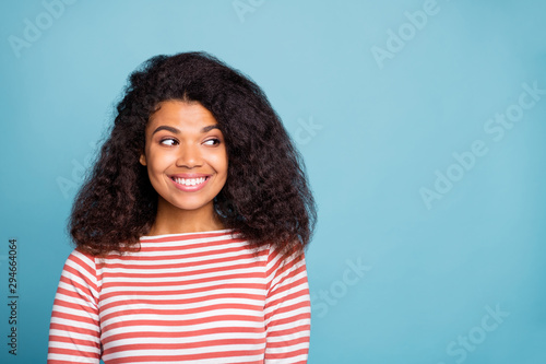 Close-up portrait of her she nice attractive lovely cute foxy cunning girlish cheerful cheery wavy-haired girl wearing striped pullover looking aside isolated on blue turquoise pastel color background