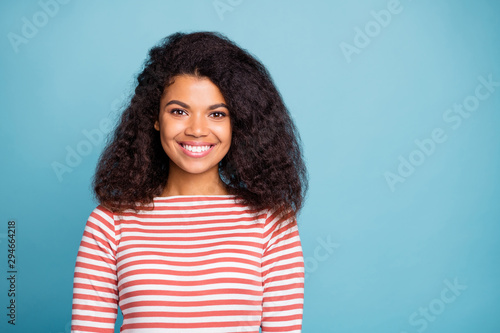 Close-up portrait of her she nice pretty attractive lovely cute cheerful cheery wavy-haired girl wearing striped pullover isolated over blue turquoise pastel color background