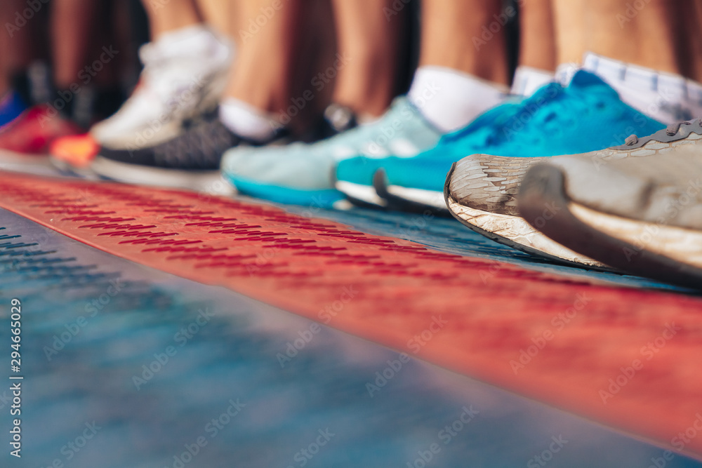 Fototapety, obrazy: Marathon runners shoes in front of the start line Close up