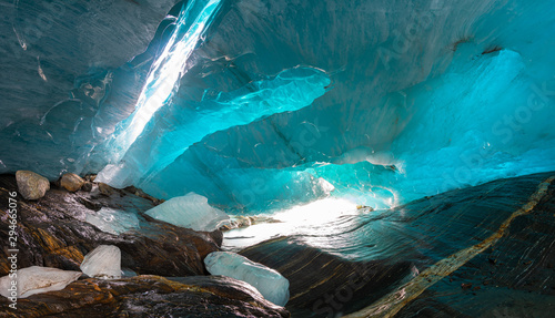 Papiers peints Bleu vert beautiful blue ice glacier cave grotto inside the mountain glacier Alibek, Dombay