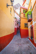 Kiss Alley In Guanajuato. Colonial And Colorful Alleys With Balconies In Mexico.